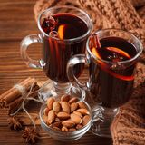 Winter horizontal mulled wine banner. Glasses with hot red wine and spices on wooden background. Stock Photography