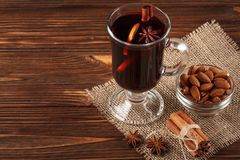 Winter horizontal mulled wine banner. Glasses with hot red wine and spices on wooden background. Royalty Free Stock Photography