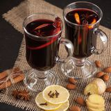 Winter horizontal mulled wine banner. Glasses with hot red wine and spices on dark background. Royalty Free Stock Photo