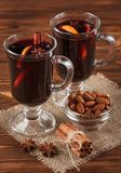 Winter horizontal mulled wine banner. Glasses with hot red wine and spices on wooden background. Royalty Free Stock Photos