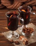 Winter horizontal mulled wine banner. Glasses with hot red wine and spices on wooden background. Royalty Free Stock Photo