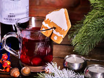 Winter hot drink with cookie and bottle of wine. Stock Images