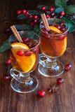 Winter hot drink. Hot drink, cranberry punch with orange, cinnamon and anise. Winter and Christmas festive decor Royalty Free Stock Photo
