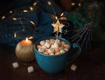 Winter hot drink with marshmallows. Cup of coffee at the table with Christmas decor stock photos