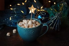 Winter hot drink with marshmallows. Cup of coffee at the table with Christmas decor stock photo