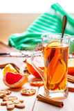 Winter hot drink with spices on wooden table. Royalty Free Stock Images