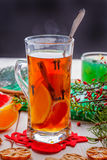 Winter hot drink with spices on wooden table. Royalty Free Stock Photo