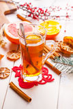 Winter hot drink with spices on wooden table. Royalty Free Stock Photos