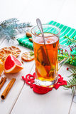 Winter hot drink with spices on wooden table. Stock Image