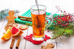 Winter hot drink with spices on wooden table. Stock Photography