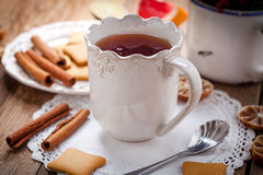Winter hot drink with spices on wooden table. Royalty Free Stock Photography