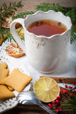 Winter hot drink with spices on wooden table. Stock Photo