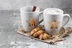 Winter hot sweet drink cups with gift boxes royalty free stock photo