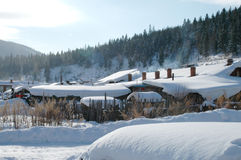 Winter house. In the mountains on beautiful sunny day, china snow town Royalty Free Stock Image