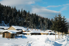 Winter house. In the mountains on beautiful sunny day, china snow town Stock Image