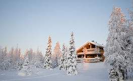 Winter house. Wooden house in winter forest Stock Image