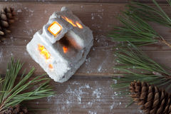 Winter house candle and Christmas tree branches Royalty Free Stock Photo