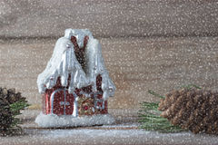Winter house candle and Christmas tree branches Royalty Free Stock Photography