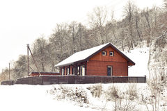 Winter house in countryside Stock Photos