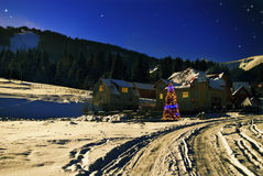 Winter house in fir-tree forest Stock Photo