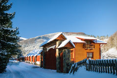 Winter house in forest Stock Photography