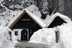 Winter house. In the forest under the heavy snow with lots of cleaned snow all around the place Stock Images