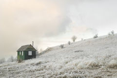 Small house and winter road Stock Photo