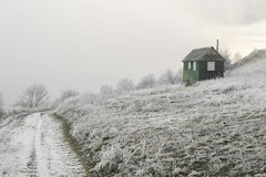Small house and winter road Stock Image