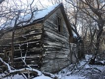 Winter house. Old house in winter time Royalty Free Stock Photo