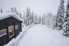 Winter house in Rukka, Finland Royalty Free Stock Images