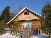 Winter house in Siberia Royalty Free Stock Photos