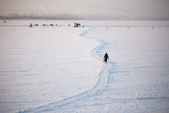 Winter ice crossing over the Dvina near the city Stock Photo