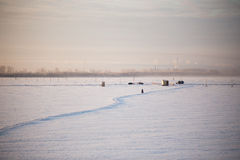 Winter ice crossing over the Dvina near the city Royalty Free Stock Photography