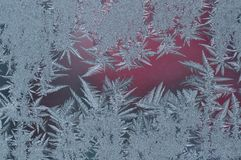 Frozen glass with ice. Winter ice frost, frozen background. Macro detail of frosted window glass texture Stock Photos