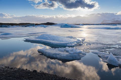 Winter ice landscape on Jokulsarlon lake Iceland with beautiful blue sky during sunset Stock Photography