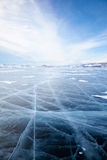 Winter ice landscape on lake Baikal with dramatic weather clouds Royalty Free Stock Images