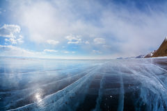 Winter ice landscape on Siberian lake Baikal with clouds Stock Photos
