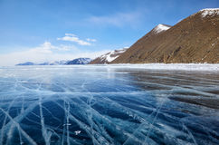 Winter ice landscape on Siberian lake Baikal with clouds Stock Images