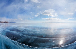Winter ice landscape on Siberian lake Baikal with clouds Royalty Free Stock Images