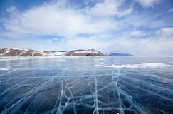 Winter ice landscape on Siberian lake Baikal with clouds Royalty Free Stock Photography