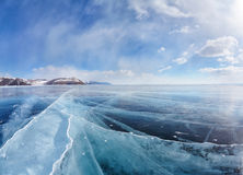 Winter ice landscape on Siberian lake Baikal with clouds Royalty Free Stock Photo