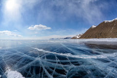 Winter ice landscape on Siberian lake Baikal with clouds. Wide angle shot of winter ice landscape on Siberian lake Baikal with dramatic weather clouds on blue stock photos