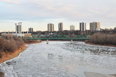 Winter ice river and city stock images