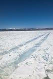 Winter ice road through Baikal Stock Photography