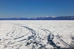 Winter ice road through Baikal stock image