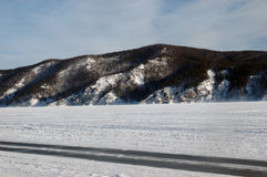 Winter ice road on the Stood sea. Winter ice road on the stood Krasnoyarsk water basin Stock Photo