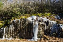 Winter Ice on a Rock Formation. Winter ice formation located on the Blue Ridge Parkway, Floyd County, Virginia, USA stock images