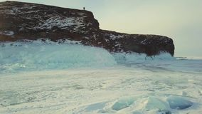 Winter ice rock Olkhon Island on Lake Baikal in a small sea, aerial photography stock footage