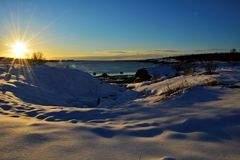 Winter in Iceland. Sunset on a snowy day in Iceland royalty free stock photo