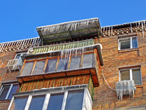 Winter icicles heap on the building roof, Stock Photography